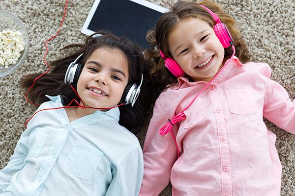 Girls lying and listening music
